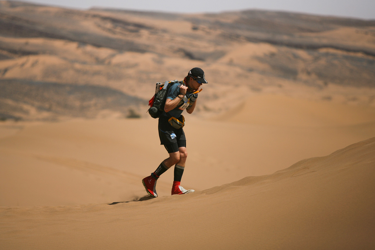 Marathon Des Sables - A lone runner on the dunes