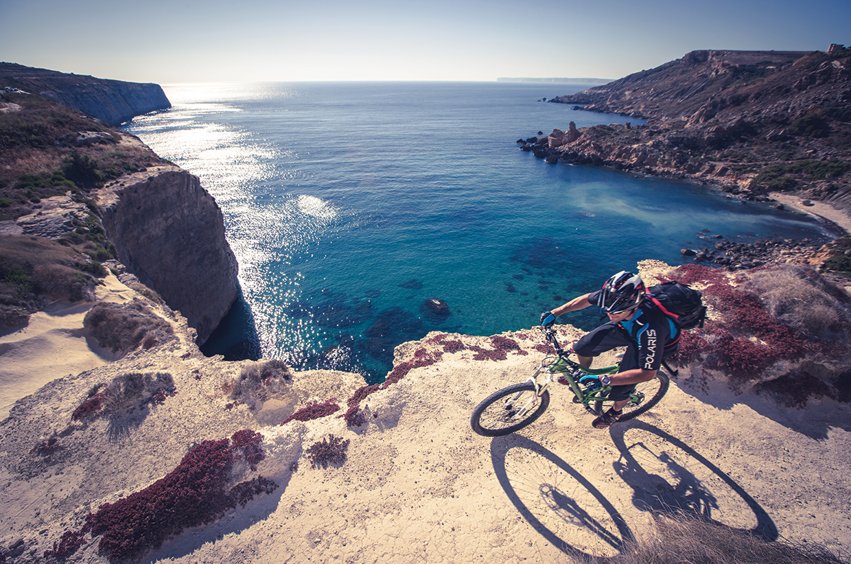 Riding along the cliff tops in Malta. Photo by Chris Davies