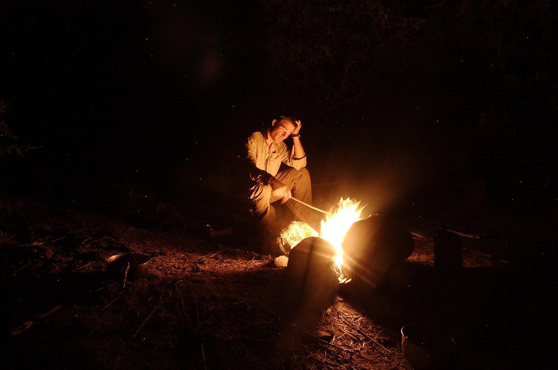 Jamie Bunchuk sits by a fire in Tajikistan