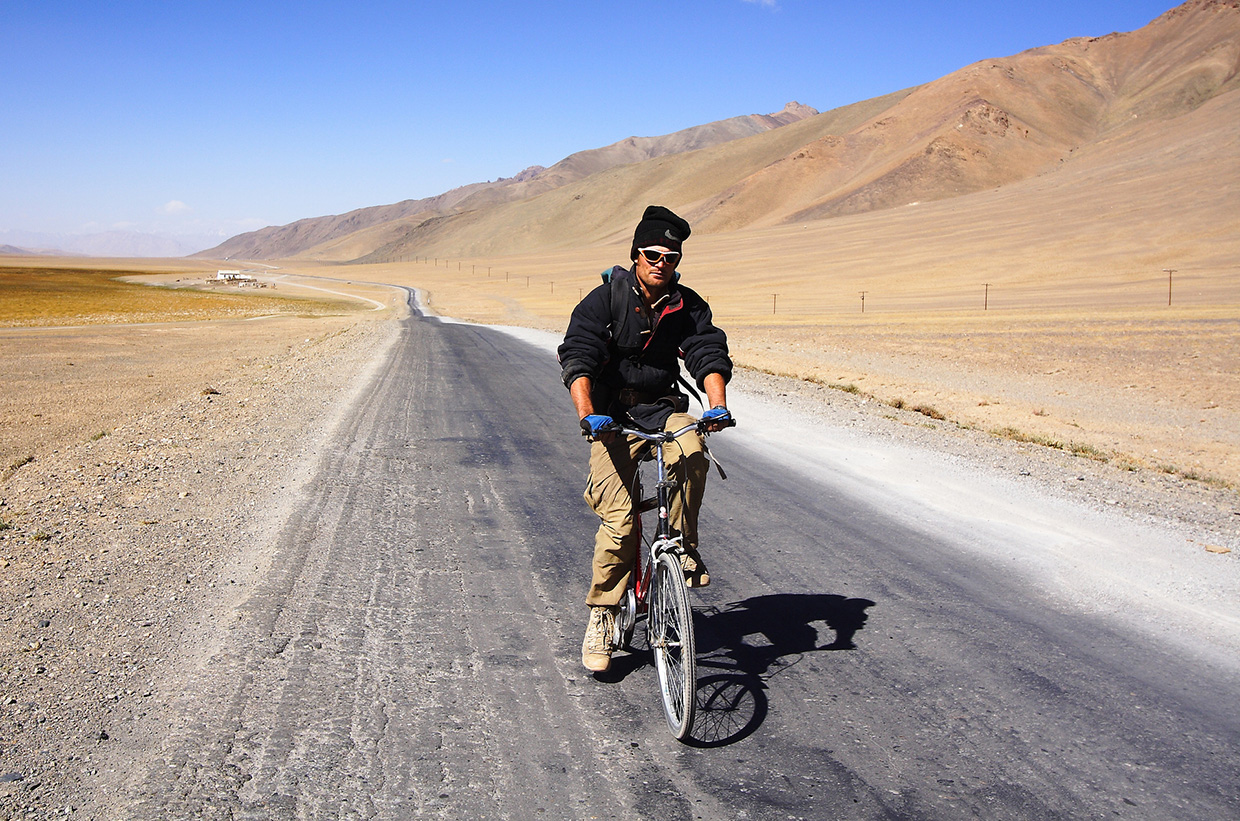 Riding a bike along the deserted Tajikistan highway