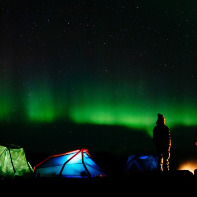 Camping under the Northern Lights. Photo by James Bowden