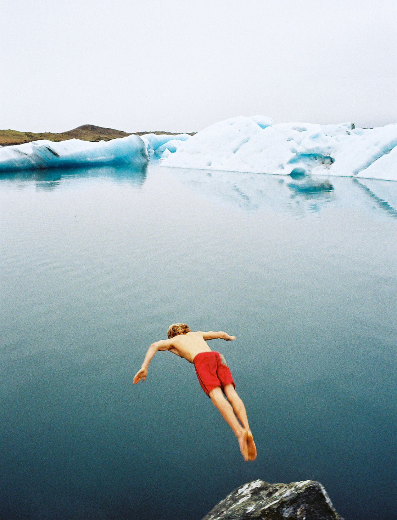 Diving into glacial Iceland waters. Photo by James Bowden
