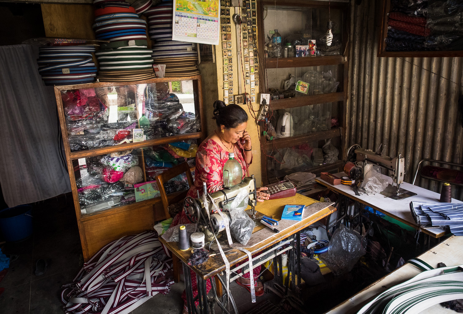A local shopkeeper making belts in Thimi