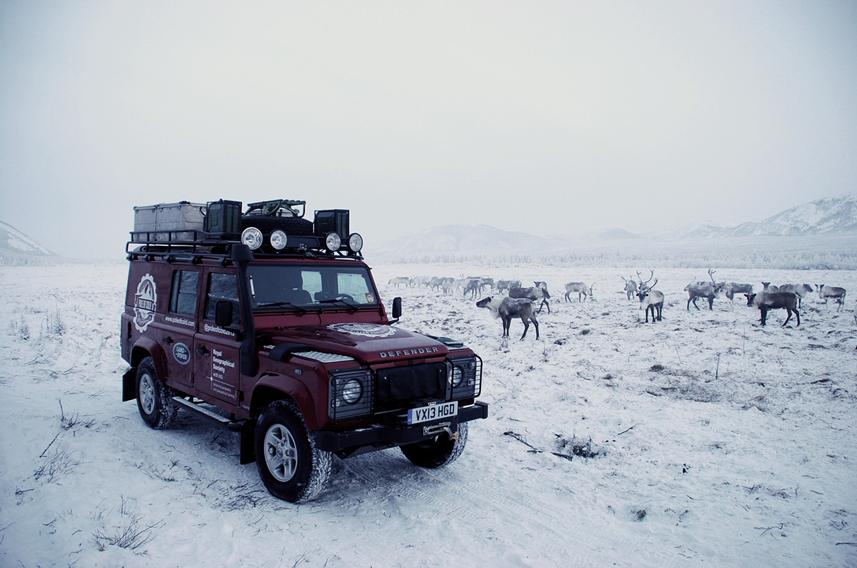 The-Pole-of-Cold-expedition-Land-Rover-surrounded-by-the-Eveni-herd