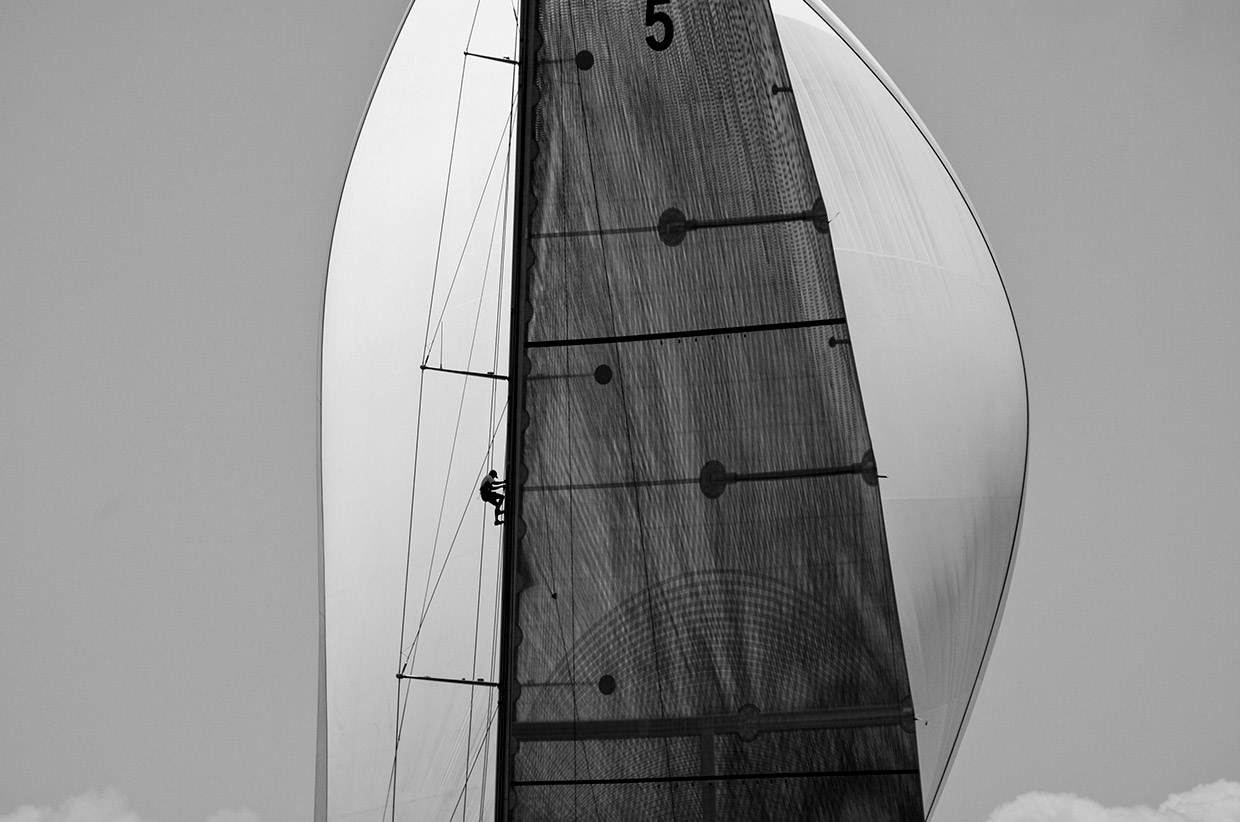 A sailor climbs the mast of the J Boat, Ranger, during Antigua Sailing Week in Antigua on the 20th April 2008