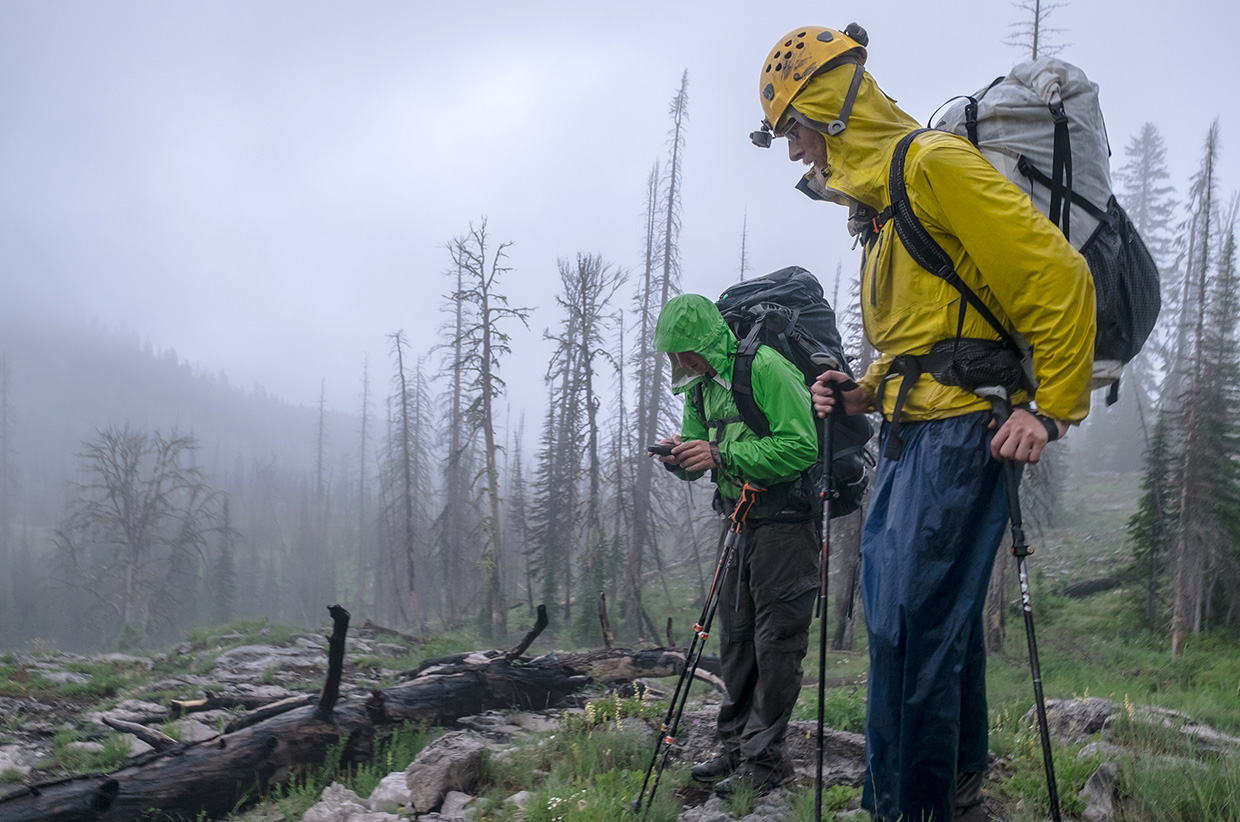 Navigating back to camp in rain and fog.