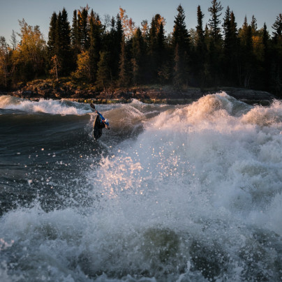 Ben Marr surfs Dream Wave at bladder falls during sunrise on the Nelson River , Manitoba.,Friday September 16, 2016.    Photo/David Jackson